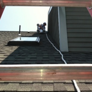 exterior painter on the roof for home decorators inc