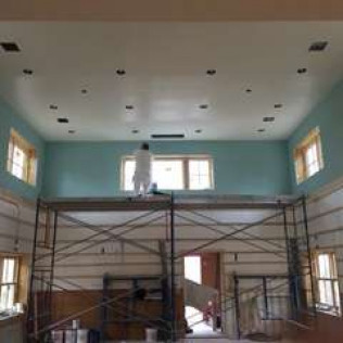 commercial interior of a building being painted