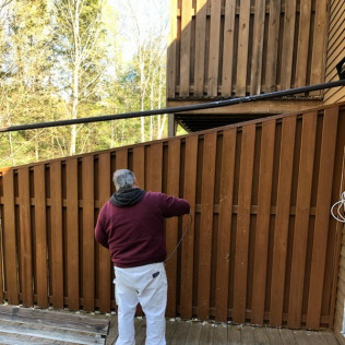 fence being painted by home decorators